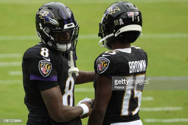 Quarterback Lamar Jackson and wide receiver Marquise Brown of the Baltimore Ravens look on before playing against the Tennessee Titans at M&T Bank...