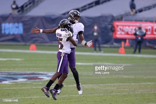 Quarterback Lamar Jackson and wide receiver Marquise Brown of the Baltimore Ravens celebrate their 20-13 victory over the Tennessee Titans following...