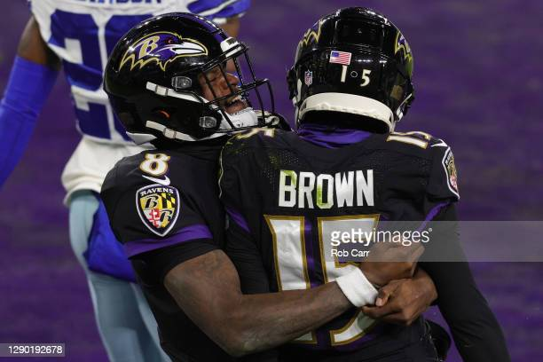 Quarterback Lamar Jackson celebrates after throwing a touchdown pass to teammate Marquise Brown of the Baltimore Ravens against the Dallas Cowboys...
