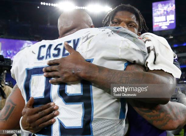 Quarterback Lamar Jackson of the Baltimore Ravens and Jurrell Casey of the Tennessee Titans embrace after the Titans win the AFC Divisional Playoff...