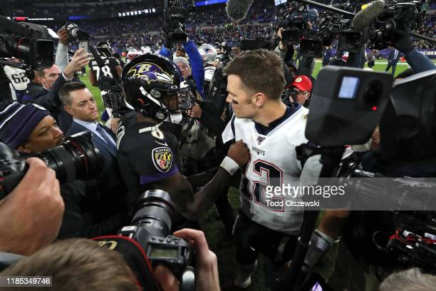 Quarterback Lamar Jackson of the Baltimore Ravens and quarterback Tom Brady of the New England Patriots talk after the Ravens defeated the Patriots...