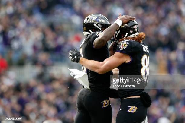 Quarterback Lamar Jackson of the Baltimore Ravens and tight end Hayden Hurst celebrate after a touchdown in the first quarter against the Cincinnati...