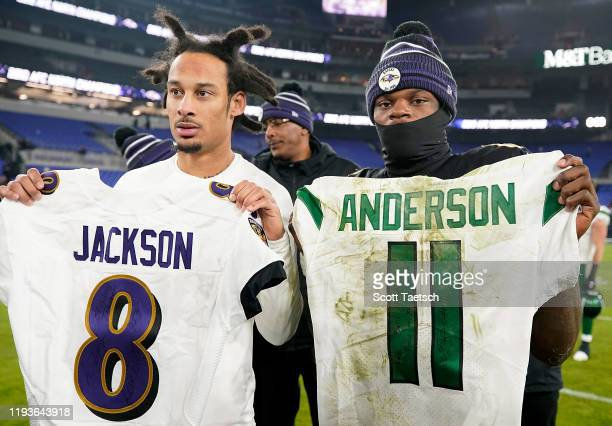 Quarterback Lamar Jackson of the Baltimore Ravens and wide receiver Robby Anderson of the New York Jets exchange jerseys after the game at M&T Bank...