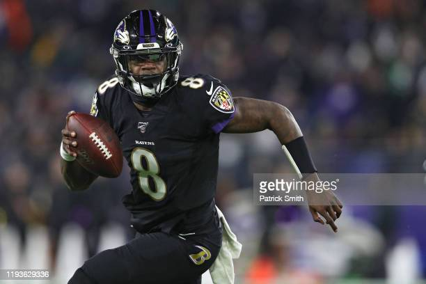 Quarterback Lamar Jackson of the Baltimore Ravens breaks NFL single season record for rushing yards by a quarterback formerly held by Michael Vick in...