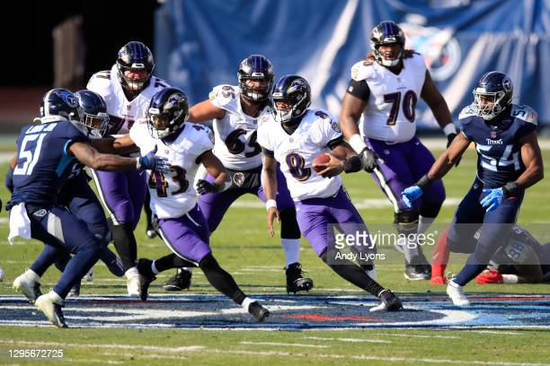 Quarterback Lamar Jackson of the Baltimore Ravens carries the ball for yardage during the first half of their AFC Wild Card Playoff game against the...