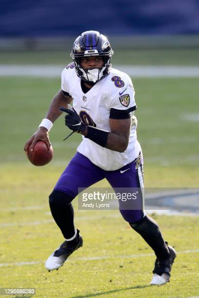 Quarterback Lamar Jackson of the Baltimore Ravens carries the ball for yardage during the fourth quarter of their AFC Wild Card Playoff game against...