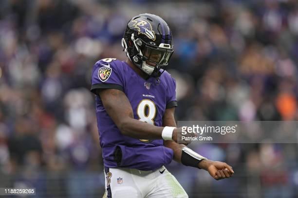 Quarterback Lamar Jackson of the Baltimore Ravens celebrates a touchdown pass to running back Mark Ingram of the Baltimore Ravens against the Houston...