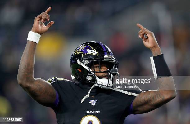 Quarterback Lamar Jackson of the Baltimore Ravens celebrates a touchdown pass in the third quarter of the game against the New York Jets at MT Bank...