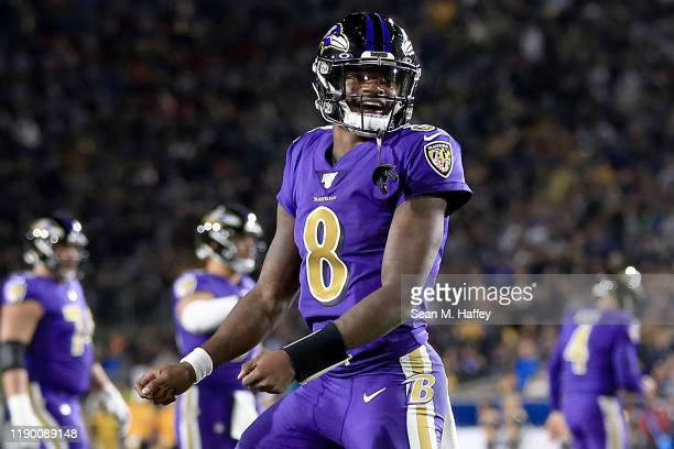 Quarterback Lamar Jackson of the Baltimore Ravens celebrates a play during the game against the Los Angeles Rams at Los Angeles Memorial Coliseum on...