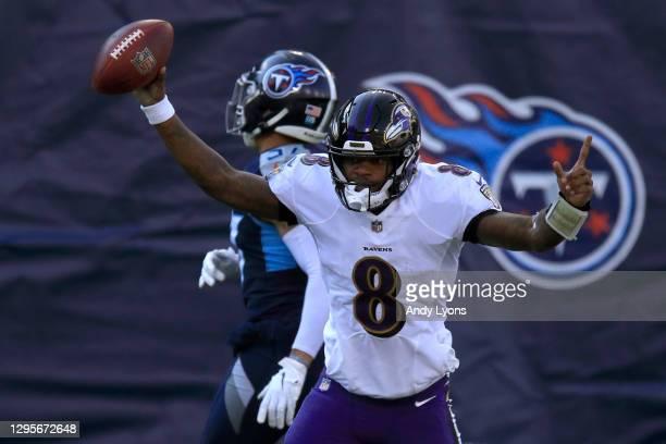 Quarterback Lamar Jackson of the Baltimore Ravens celebrates following a 48-yard touchdown run during the second quarter of their AFC Wild Card...