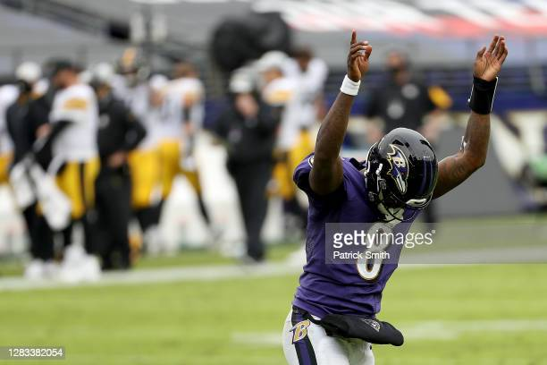 Quarterback Lamar Jackson of the Baltimore Ravens celebrates a second quarter touchdown against the Pittsburgh Steelers at M&T Bank Stadium on...