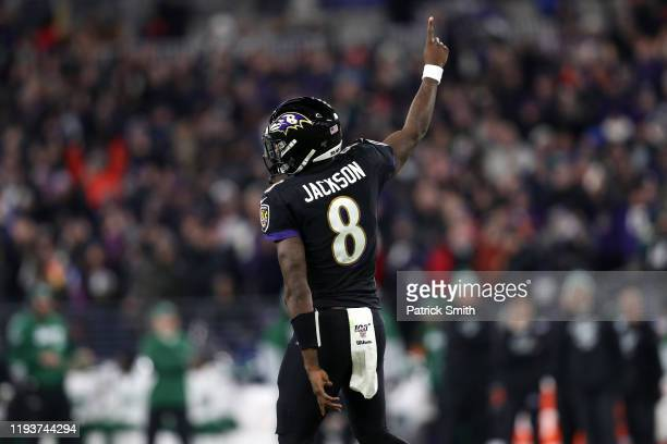 Quarterback Lamar Jackson of the Baltimore Ravens celebrates after a touchdown in the first quarter of the game against the New York Jets at MT Bank...
