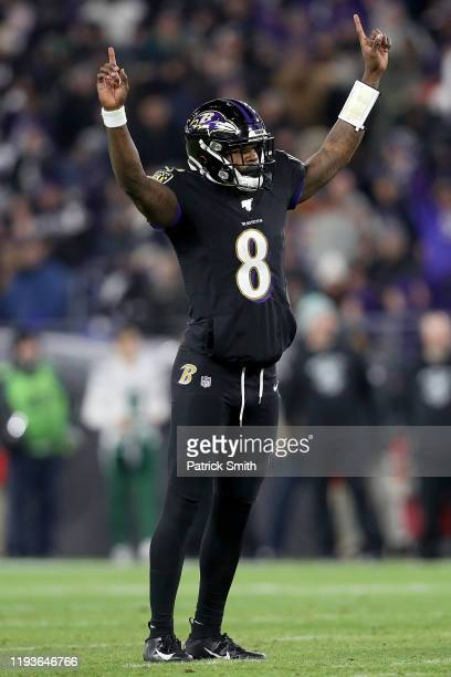 Quarterback Lamar Jackson of the Baltimore Ravens celebrates during the game against the New York Jets at MT Bank Stadium on December 12 2019 in...