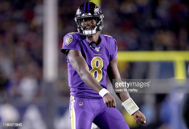 Quarterback Lamar Jackson of the Baltimore Ravens celebrates his second pass for a touchdown to wide receiver Marquise Brown in the first quarter of...
