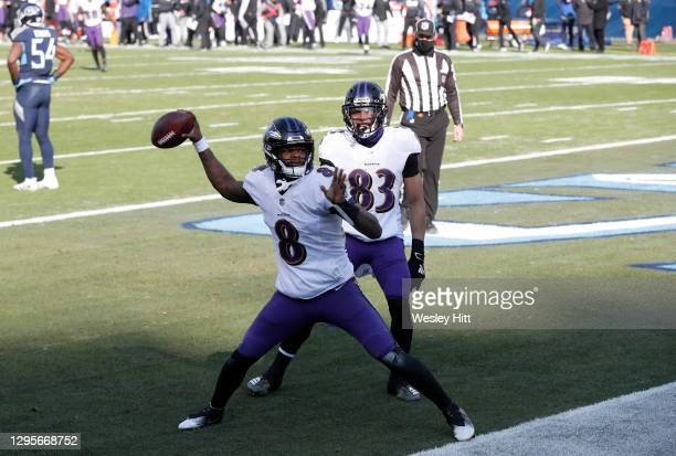 Quarterback Lamar Jackson of the Baltimore Ravens celebrates with teammate wide receiver Willie Snead IV following a 48-yard touchdown run by Jackson...