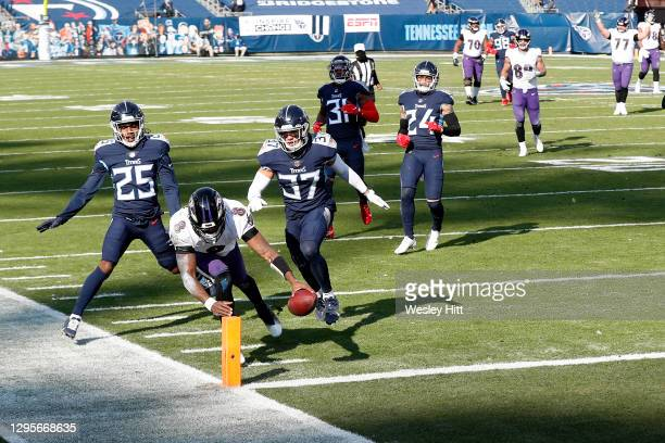 Quarterback Lamar Jackson of the Baltimore Ravens dives into the end zone to score a 48-yard touchdown run during the second quarter of their AFC...