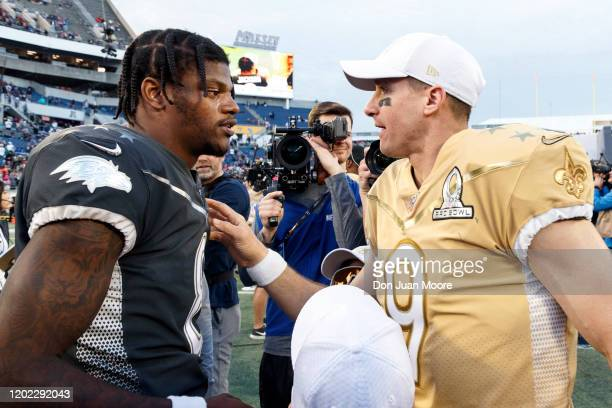 Quarterback Lamar Jackson of the Baltimore Ravens from the AFC Team talk with Quarterback Drew Brees of the New Orleans Saints from the NFC Team...