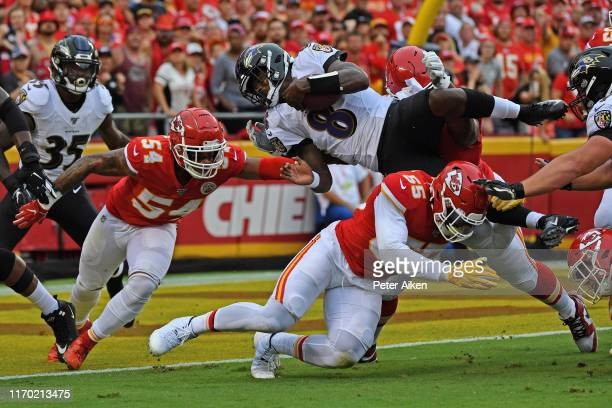 Quarterback Lamar Jackson of the Baltimore Ravens gets stopped at the goal line attempting a two point conversion against defensive end Frank Clark...