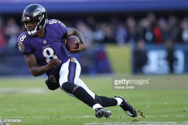 Quarterback Lamar Jackson of the Baltimore Ravens in action against the Los Angeles Chargers during the AFC Wild Card Playoff game at MT Bank Stadium...