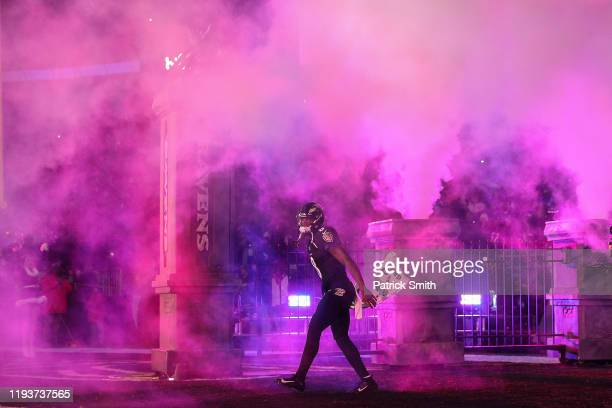Quarterback Lamar Jackson of the Baltimore Ravens is introduced before playing against the New York Jets at MT Bank Stadium on December 12 2019 in...