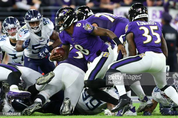 Quarterback Lamar Jackson of the Baltimore Ravens is stopped short by the Tennessee Titans defense on fourth down in the second half during the AFC...
