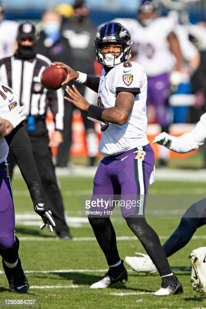 Quarterback Lamar Jackson of the Baltimore Ravens looks for a receiver during their AFC Wild Card Playoff game against the Tennessee Titans at Nissan...