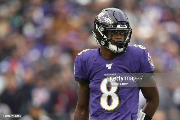 Quarterback Lamar Jackson of the Baltimore Ravens looks on against the Houston Texans during the first quarter at MT Bank Stadium on November 17 2019...