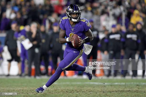 Quarterback Lamar Jackson of the Baltimore Ravens looks to deliver a pass over the defense of the Los Angeles Rams at Los Angeles Memorial Coliseum...