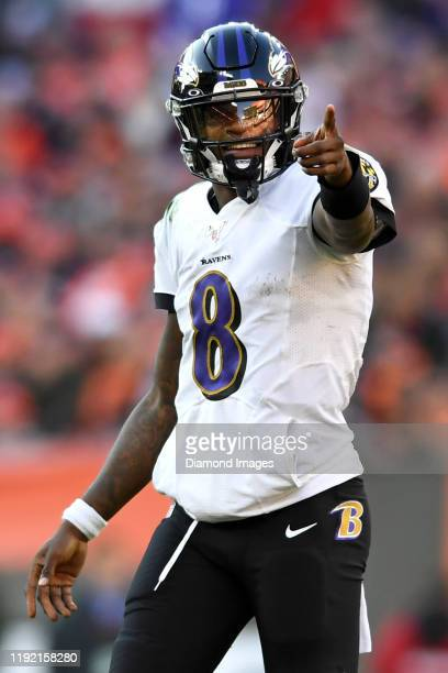 Quarterback Lamar Jackson of the Baltimore Ravens points toward the defense in the fourth quarter of a game against the Cleveland Browns on December...