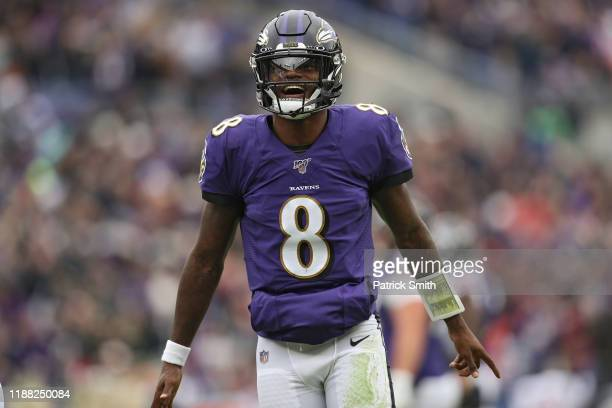 Quarterback Lamar Jackson of the Baltimore Ravens reacts after throwing a touchdown pass to tight end Mark Andrews of the Baltimore Ravens against...