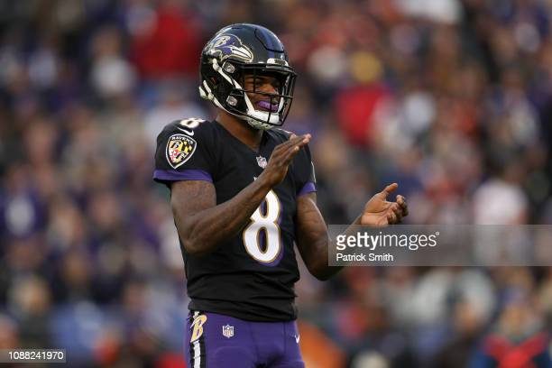 Quarterback Lamar Jackson of the Baltimore Ravens reacts after a play in the first quarter against the Cleveland Browns at MT Bank Stadium on...