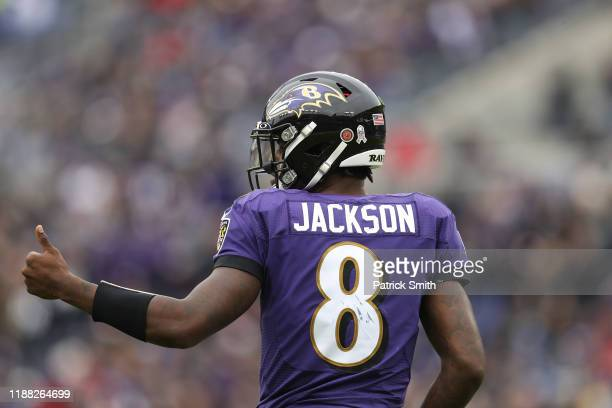 Quarterback Lamar Jackson of the Baltimore Ravens reacts with a thumbsup against the Houston Texans during the second quarter at MT Bank Stadium on...