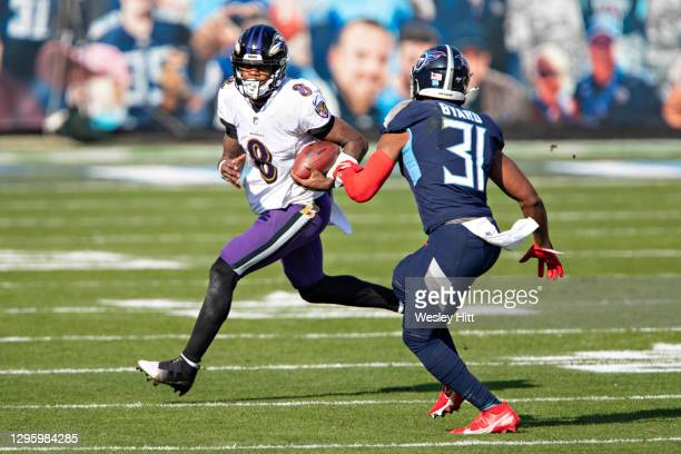 Quarterback Lamar Jackson of the Baltimore Ravens runs the ball during their AFC Wild Card Playoff game against the Tennessee Titans at Nissan...