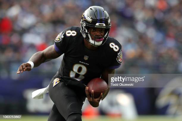 Quarterback Lamar Jackson of the Baltimore Ravens runs with the ball in the first quarter against the Cincinnati Bengals at MT Bank Stadium on...