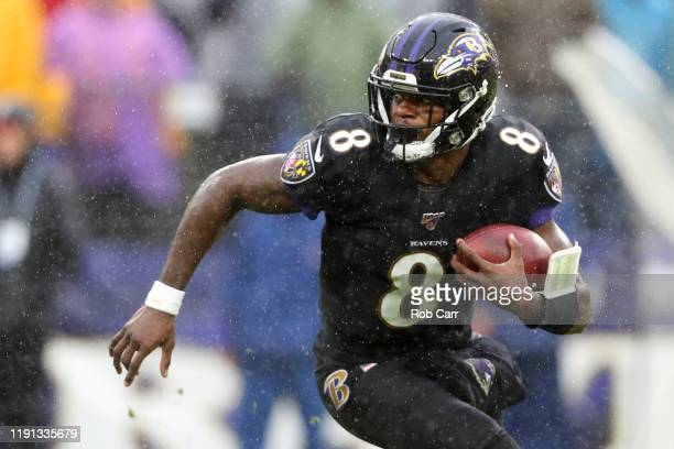Quarterback Lamar Jackson of the Baltimore Ravens runs with the ball against the San Francisco 49ers in the first half at MT Bank Stadium on December...