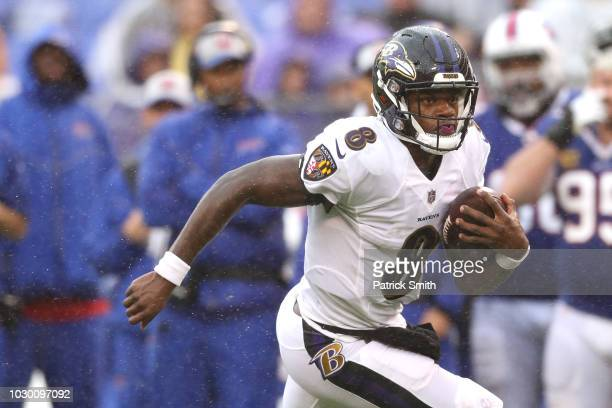 Quarterback Lamar Jackson of the Baltimore Ravens rushes against the Buffalo Bills during the second half at MT Bank Stadium on September 9 2018 in...
