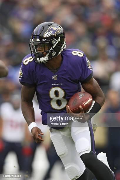 Quarterback Lamar Jackson of the Baltimore Ravens rushes against the Houston Texans during the second quarter at MT Bank Stadium on November 17 2019...