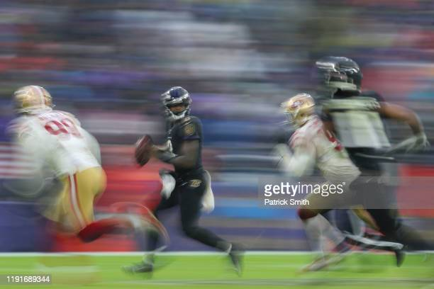 Quarterback Lamar Jackson of the Baltimore Ravens rushes against the San Francisco 49ers during the second half at MT Bank Stadium on December 01...