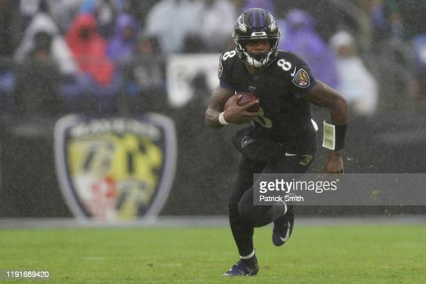 Quarterback Lamar Jackson of the Baltimore Ravens rushes against the San Francisco 49ers during the third quarter at MT Bank Stadium on December 01...