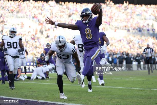 Quarterback Lamar Jackson of the Baltimore Ravens rushes for a touchdown in the third quarter against the Oakland Raiders at MT Bank Stadium on...