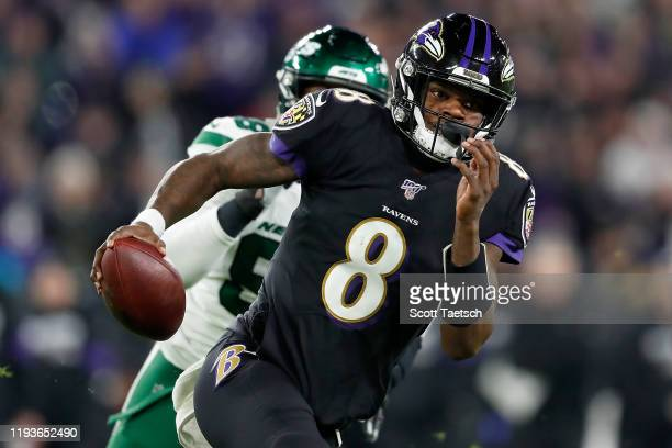 Quarterback Lamar Jackson of the Baltimore Ravens scrambles against the defense of the New York Jets during the game at M&T Bank Stadium on December...