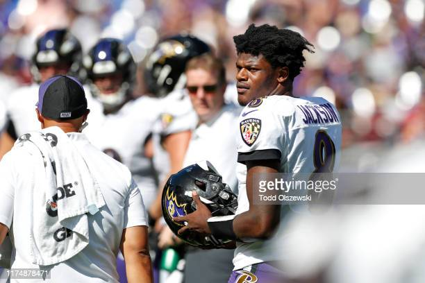Quarterback Lamar Jackson of the Baltimore Ravens stands on the field during the second half against the Arizona Cardinals at MT Bank Stadium on...