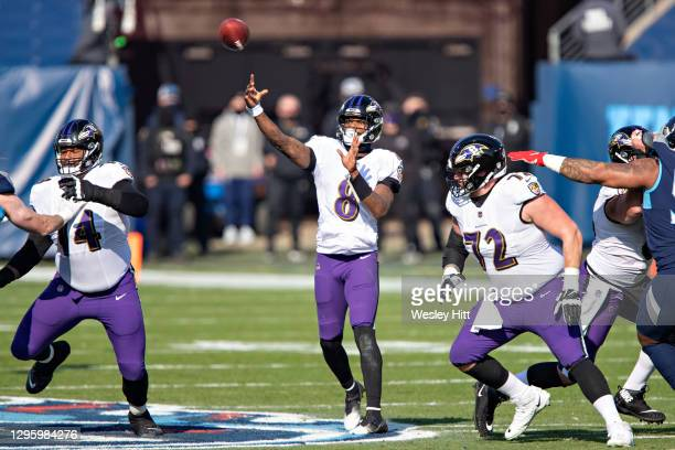 Quarterback Lamar Jackson of the Baltimore Ravens throws a pass during their AFC Wild Card Playoff game against the Tennessee Titans at Nissan...