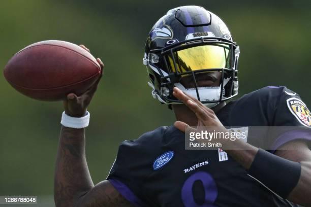 Quarterback Lamar Jackson of the Baltimore Ravens throws a pass during the Baltimore Ravens Training Camp at Under Armour Performance Center...