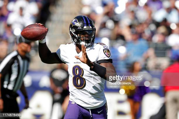 Quarterback Lamar Jackson of the Baltimore Ravens throws the ball against the Arizona Cardinals during the second half at MT Bank Stadium on...