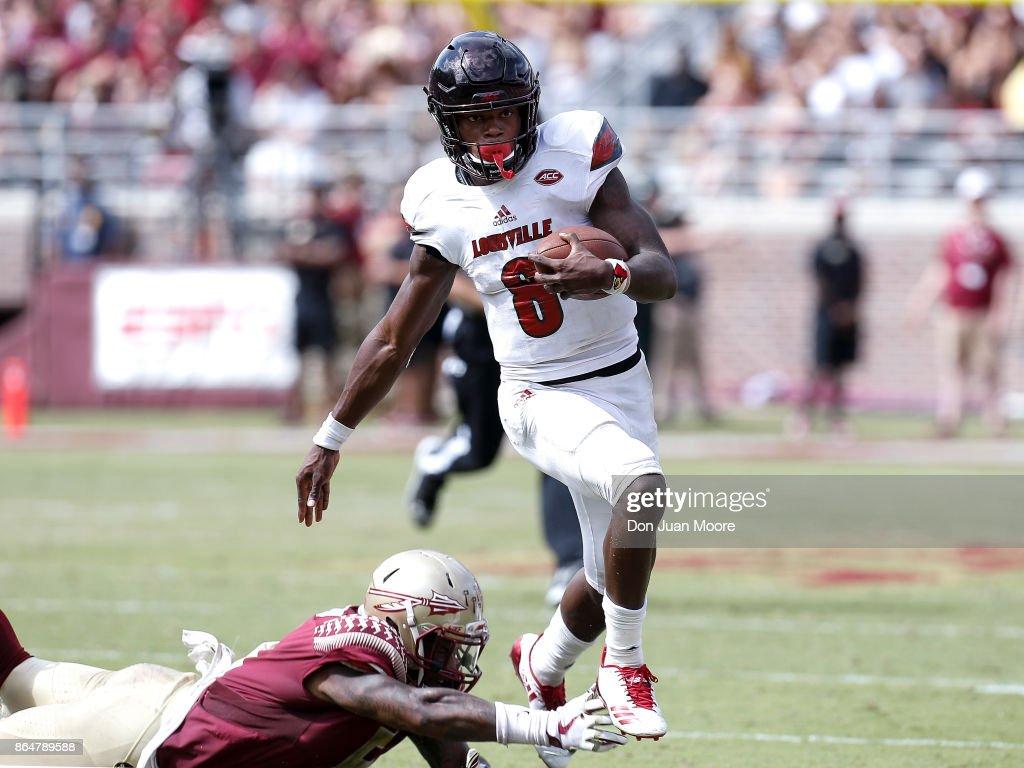 Quarterback Lamar Jackson 8 Of The Louisville Cardinals Avoids A Tackle By Linebacker Dontavious