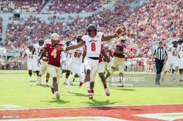 Quarterback Lamar Jackson of the Louisville Cardinals runs the ball into the endzone for a touchdown during their game against the Florida State...