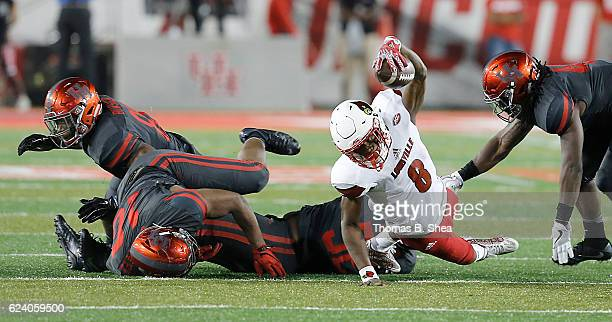 Quarterback Lamar Jackson of the Louisville Cardinals stretches for first down against the Houston Cougars in the third quarter at TDECU Stadium on...