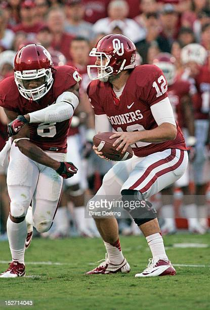Quarterback Landry Jones and running back Dominique Whaley of the Oklahoma Sooners fake a hand off against the Kansas State Wildcats on September 22...