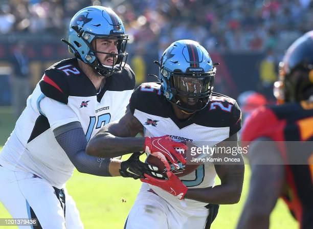Quarterback Landry Jones hands off to running back Lance Dunbar of the Dallas Renegades who gained a first down in the second half of the game...